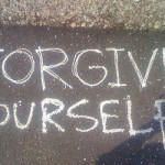 Forgive yourself written on a sidewalk
