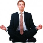 man in business suit doing yoga