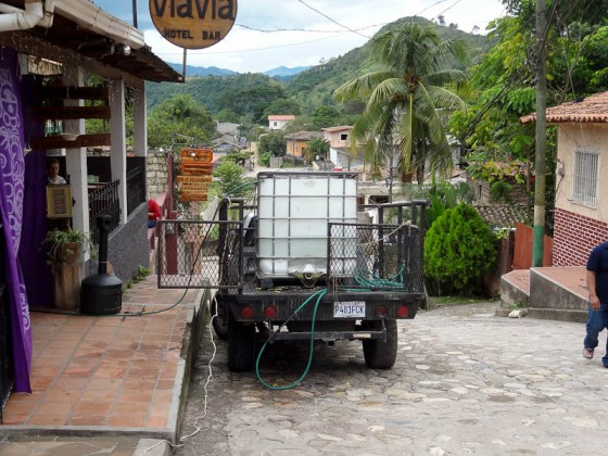 Guatemalan Truck Delivering Water To Honduran Restaurant