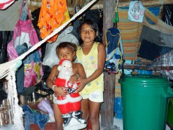Indigenous Kuna Children With Plastic Santa In Panama