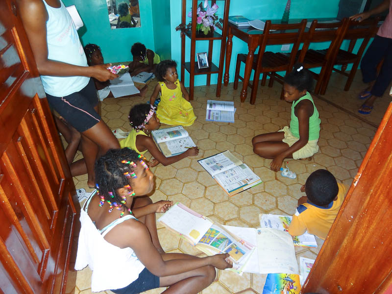 Kids Studying In A House