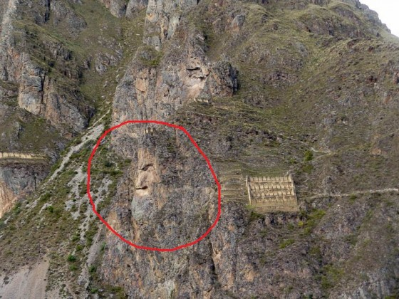 The Face Of An Incan King And Store Houses To The Right