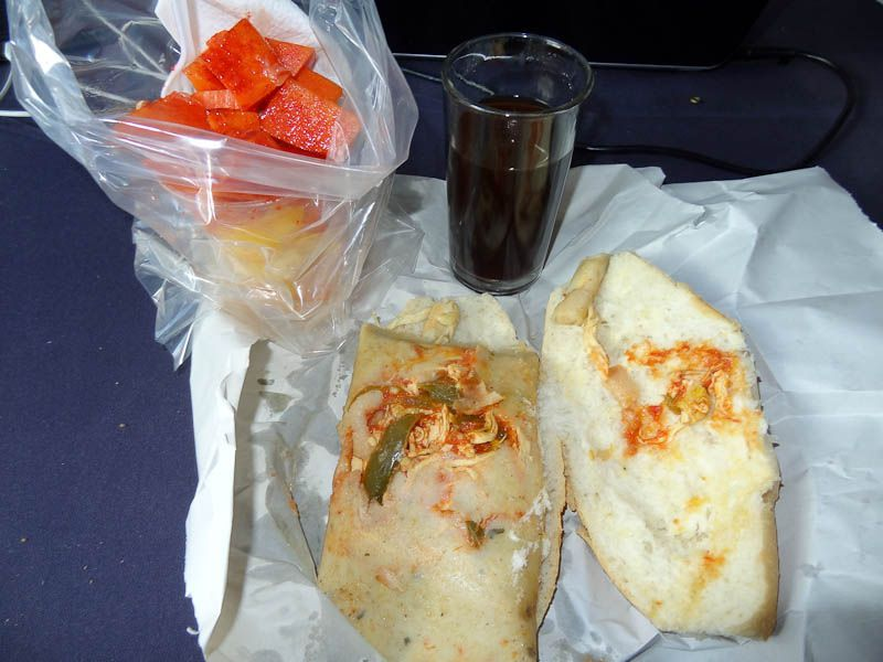 Breakfast Tamale On Bread With A Cup Of Fruit And Coffee