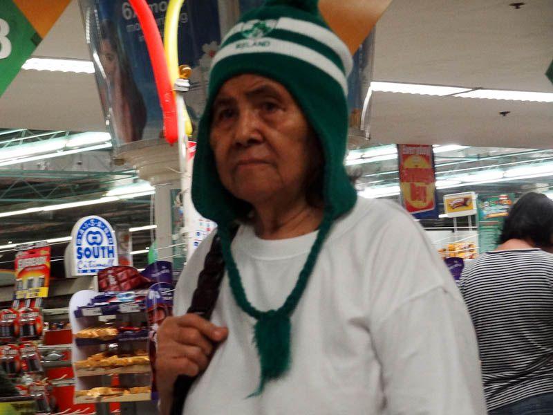 filipino grandma wearing peruvian hat
