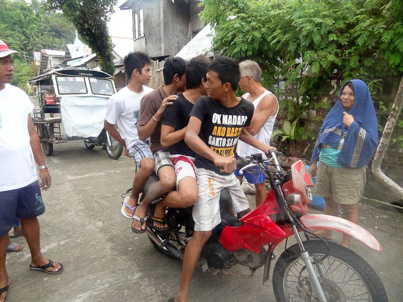four people on one motorcycle