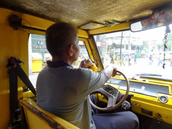 jeepney driver drinking beer and driving