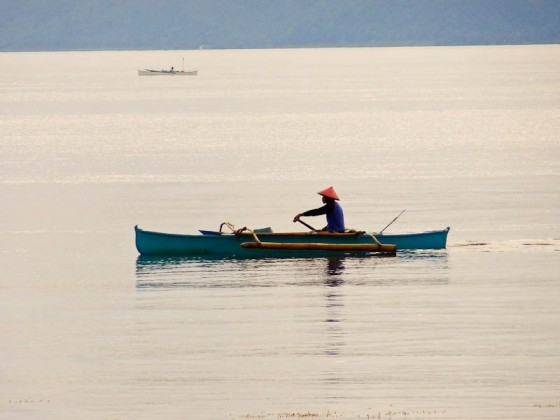 man in a boat at sea