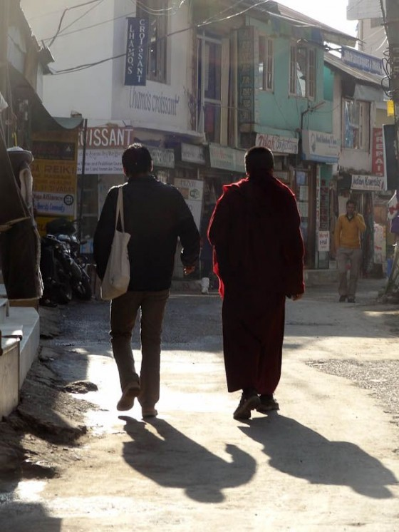 Monk And Normal Guy Walking Down The Street