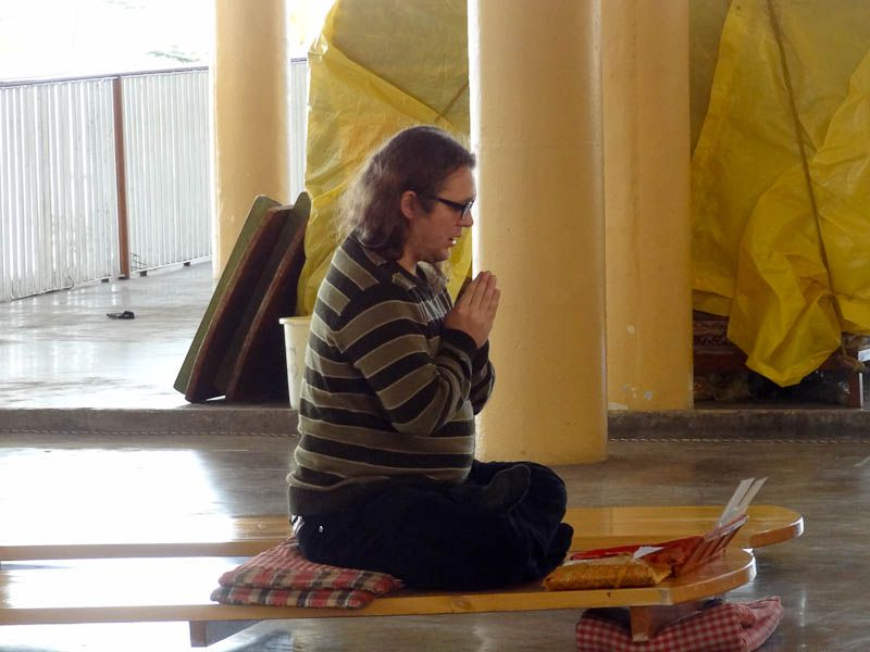 Prayer In Front Of The Temple