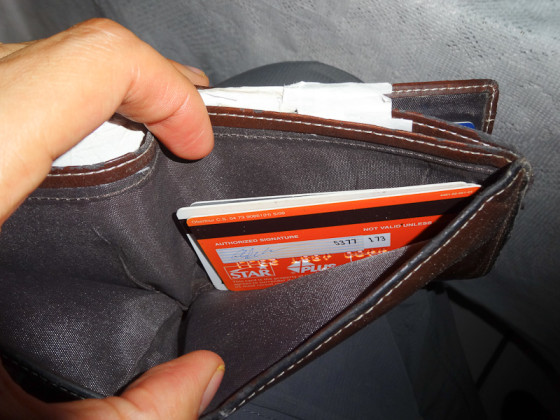 Empty Wallet And Rearranged Credit Cards