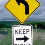 Oxymoron road sign the pursuit of happiness
