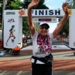 Old lady finishing marathon race Gladys Burrill
