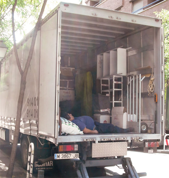 man sleeping back of truck spanish siesta