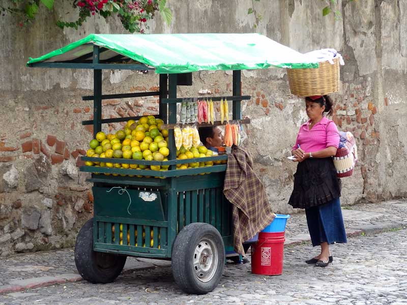 Fruit Stand With Yellow/Green Oranges