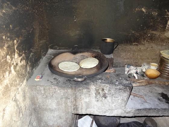 Cooking Tortillas Over A Fire