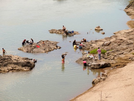 Bathing And Washing Clothes In The River