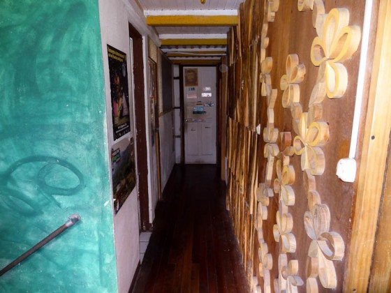 Hallway With Art And Wood Carvings