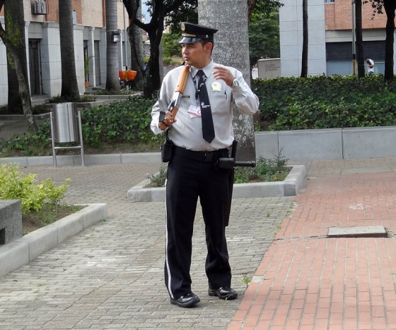 Security Guard With Rifle In A Colombian Park