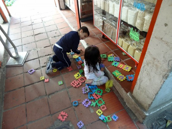 Happy Kids Playing In The Ciudad Bolivar Market