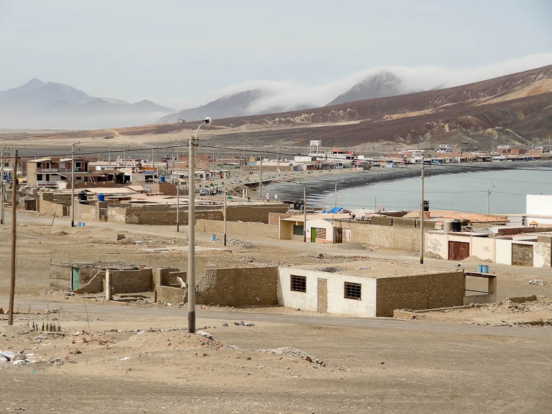 The Town With Cloud Covered Mountains