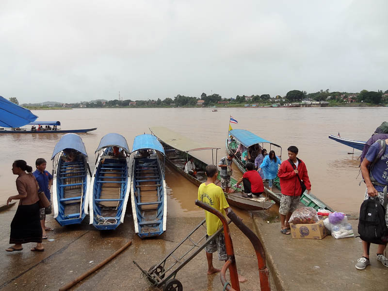 After Lao Immigration, Crossing The River By Boat To Thailand