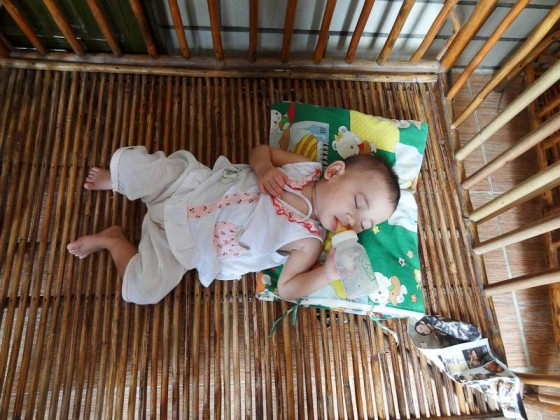 A Baby Sleeping And Eating