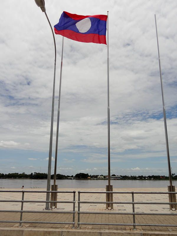 Lao Flag With Thailand In The Distance