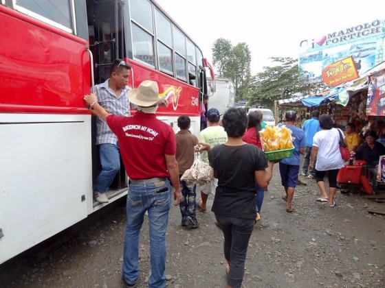 Vendors Descending On A Stopped Bus