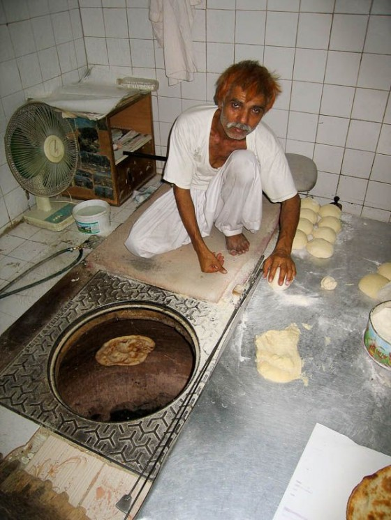 Pakistani Man Cooking Roti In A Tandoor