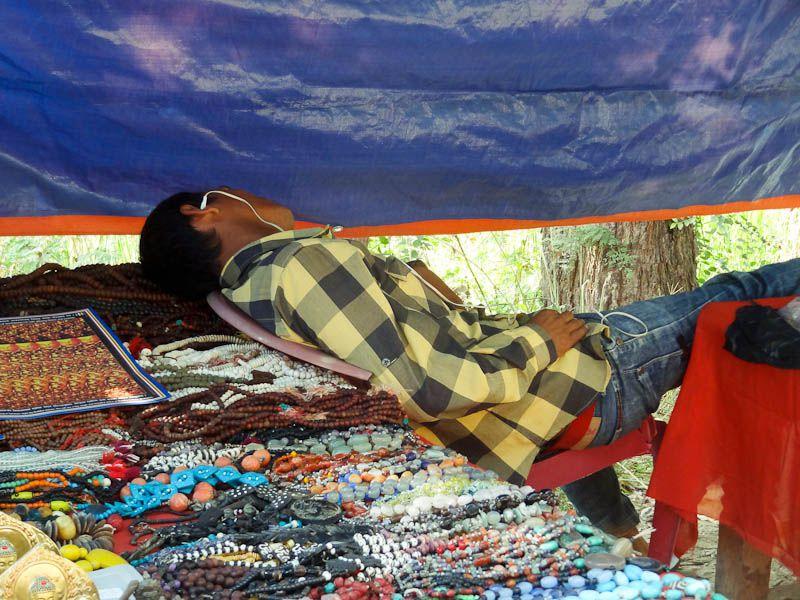 Sleeping At A Souvenir Booth