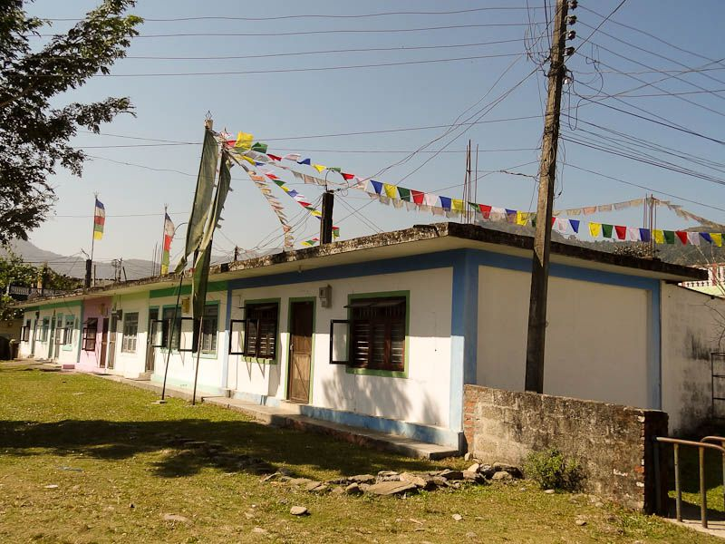 Flags Atop The Homes In The Camp