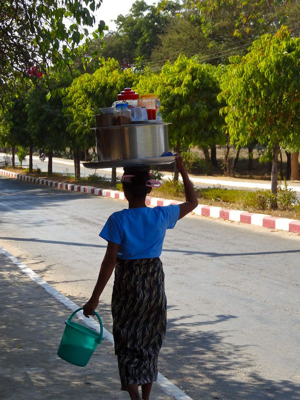 A Street Food Vendor Carrying Her Things