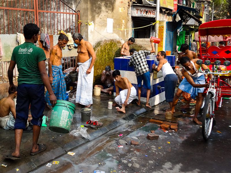 Public Bathing On A Street In Calcutta, India