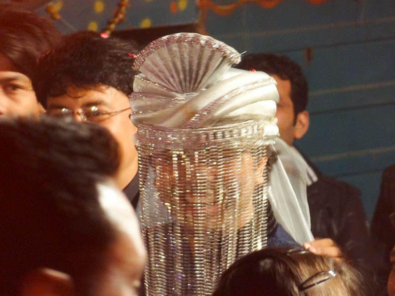 Groom Smiling Through His Burqa