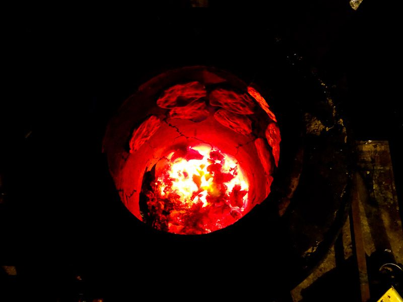 A Journey To The Center Of The Earth, Or A Tandoor Cooking Roti - Taken 24-Mar-2013 - Delhi, India