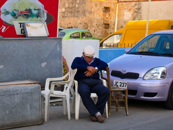 A Man Taking A Nap In The Street In Cyprus