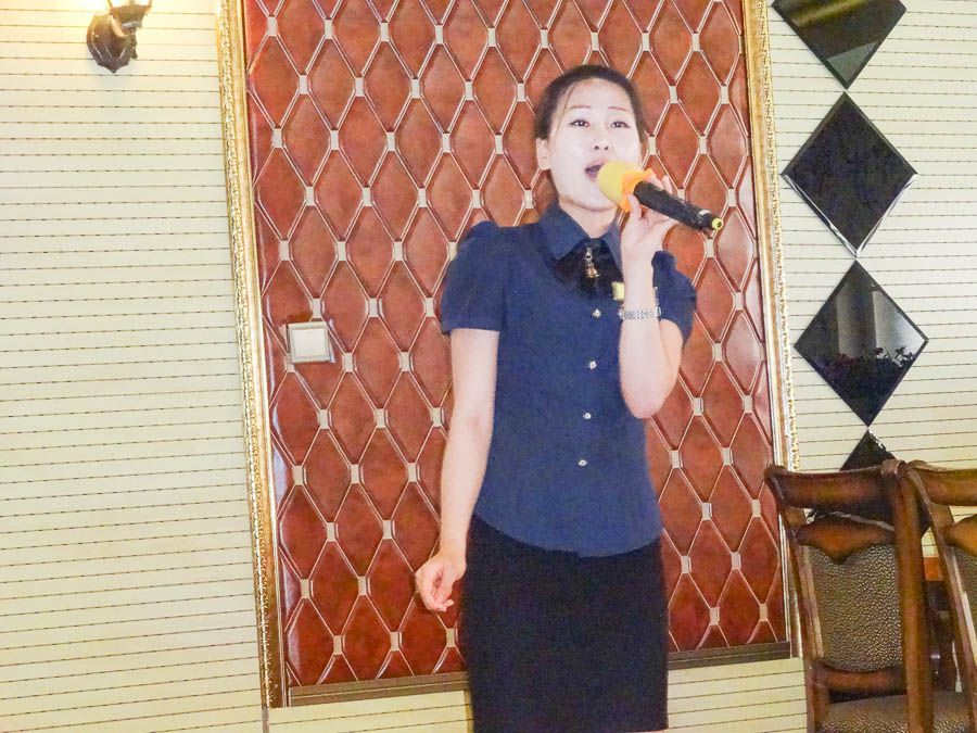 A North Korean Woman Singing Karaoke